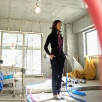 Build it and they will come: A former real estate analyst stands inside her planned Airbnb condominium under construction in Tokyo in January 2016. | BLOOMBERG