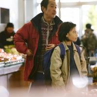 Partners in crime: Shota (Jyo Kairi) cases a shop with his father, Osamu (Lily Franky) in 'Shoplifters.' | © 2018 FUJI TELEVISION GAGA AOI PRO.