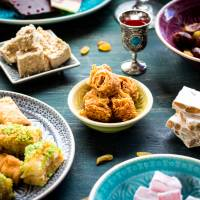 An Eid al-Fitr feast to mark the end of Ramadan. Sweeter dishes are staples of the first breakfast during the holiday that can last up to three days. | GETTY IMAGES
