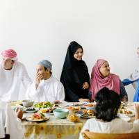 Family and friends gather after morning prayers to celebrate the end of Ramadan. In addition to sharing a lavish meal, many countries follow their own distinct traditions. Getty Images | GETTY IMAGES