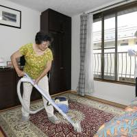 Spick and span: A couple prepare to receive guests as they start a minpaku business at their home in western Tokyo on June 15, the day the law on private lodging came into effect. | KYODO