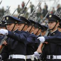 Ground Self-Defense Force personnel march in a parade Oct. 24, 2010. Under the Abe administration, Japan has been beefing up its defense capabilities as regional tensions rise. | GROUND SELF-DEFENSE FORCE