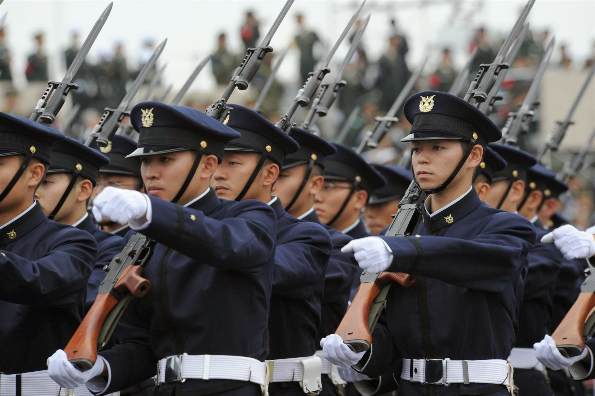 Ground Self-Defense Force personnel march in a parade Oct. 24, 2010. Under the Abe administration, Japan has been beefing up its defense capabilities as regional tensions rise.   GROUND SELF-DEFENSE FORCE