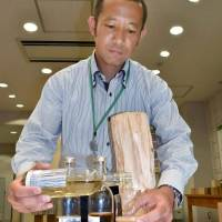 Barking up the right tree: Researchers in Tsukuba have developed a new way to make drinkable alcohol from wood. | KYODO