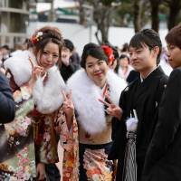 Japan is merely joining the worldwide trend by setting the age of adulthood at 18 years old. | BLOOMBERG