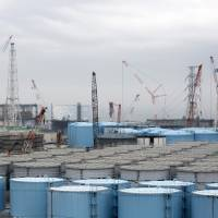 Storage tanks of contaminated water stand at Tepco's Fukushima No. 1 nuclear power plant. Tepco estimates that at the current rate it will run out of tank space in 2020, and a decision must be made on what to do with the water well before then. | BLOOMBERG