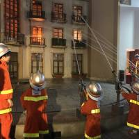 The girls try their hand at fighting at Kidzania, a work-experience theme park. | DANIELLE DEMETRIOU