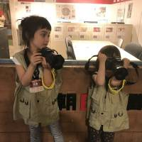 Newspaper reporters at KidZania are given SLR cameras to take photos for an article. | DANIELLE DEMETRIOU