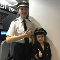 The ANA booth at KidZania has a simulator to  allow kids to experience flying a plane. | DANIELLE DEMETRIOU