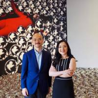 Museum MACAN Director Aaron Seeto and Fenessa Adikoesoemo, chairwoman of the MACAN Foundation, pose in front of Yayoi Kusama's 'Narcissus Garden.' | MARK THOMPSON