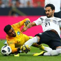 Ilkay Gundogan (right) and Germany will be trying to defend their World Cup crown in Russia this summer.   REUTERS
