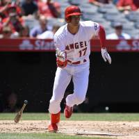 Los Angeles Angels star Shohei Ohtani will be out of action for three weeks due to an elbow injury, the team announced on Friday. | AP