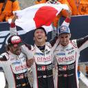 Toyota drivers Kazuki Nakajima (center) Fernando Alonso (left) and Sebastien Buemi celebrate after winning the 24 Hours of Le Mans on Sunday in Le Mans, France.