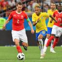 Brazil's Neymar (right) and Switzerland's Stephan Lichsteiner compete for a ball during their match at the 2018 World Cup on Sunday in Rostov-on-Don, Russia.