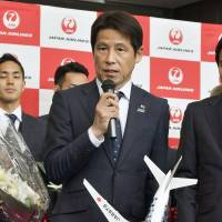 Japan men's national team soccer manager Akira Nishino speaks at a departure ceremony at Narita airport on Saturday. The team is traveling to Austria for training before the upcoming World Cup. | KYODO