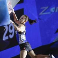 Akiyo Noguchi competes in a bouldering World Cup event in Tokyo on Sunday. | KYODO
