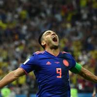 Radamel Falcao scores as Colombia beats Poland to stay alive at World Cup