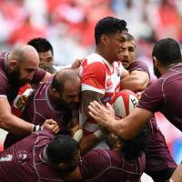 Georgia players surround Japan's Timothy Lafaele during their test match on Saturday in Toyota, Aichi Prefecture. | AFP-JIJI