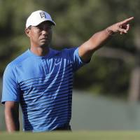Tiger Woods gestures during a practice round for the U.S. Open on Tuesday in Southampton, New York. | AP