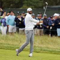 Dustin Johnson takes four-shot lead at U.S. Open