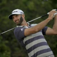 Dustin Johnson escapes wild third round with share of U.S Open lead