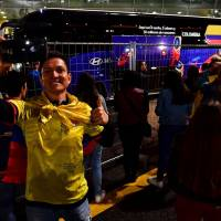 A supporter takes a selfie as the bus carrying Colombia's national soccer team prepares to leave the Kazan airport, upon arrival on Tuesday ahead of the FIFA World Cup Russia 2018. | AFP-JIJI