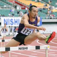 Dai Tamesue, seen competing at a track meet in May 2011 in Shizuoka Prefecture, made a name for himself as a world-class hurdler before retiring in 2012. | KYODO