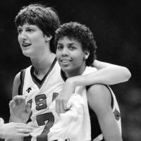 Basketball Hall of Famer Anne Donovan (left) and Cheryl Miller celebrate the team's victory over Canada at the 1984 Los Angeles Olympics. Donovan died Wednesday at the age of 56. | AP