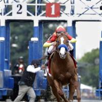 Justify, being ridden by Mike Smith, breaks out of the starting gate during the Belmont Stakes on Saturday in Elmont, New York. | AP