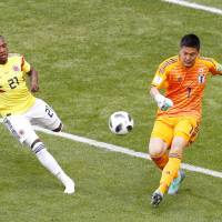 Japan resets after avenging '14 loss