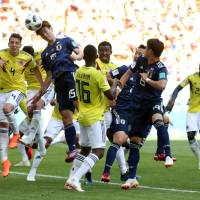 Japan's Yuya Osako scores on a header in the second half.