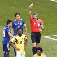 Colombia's Carlos Sanchez (6) received the first red card of the 2018 World Cup in the first half. | KYODO