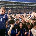 Japan supporters react during a public-viewing event of the team's game again Columbia on Monday night.