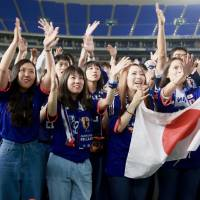 Fans send cheers in the closing minutes of the Japan-Colombia game at the Tokyo Dome public-viewing event. | KAZ NAGATSUKA