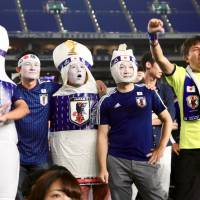 Fans dressed at bowling pins support Japan at a World Cup public-viewing event at Tokyo Dome on Tuesday night.  | KAZ NAGATSUKA