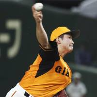 Giants starter Tomoyuki Sugano gave up 10 hits and four earned runs (five total runs) in five innings. | KYODO