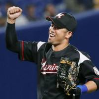 Outfielder Ikuhiro Kiyota celebrates after the Marines' victory over the Dragons on Wednesday. | KYODO