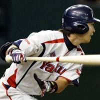 The Swallows' Norichika Aoki, seen in a 2009 file photo, belted a two-run homer in the first inning against the Dragons on Wednesday at Jingu Stadium. Tokyo Yakult defeated Chunichi 7-2. | KYODO
