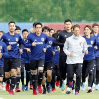 Japan national team soccer players jog during a workout on Thursday in Kazan, Russia. | KYODO