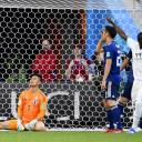 Japan goalkeeper Eiji Kawashima (left) reacts after Senegal's first goal during their match on Sunday at the World Cup.