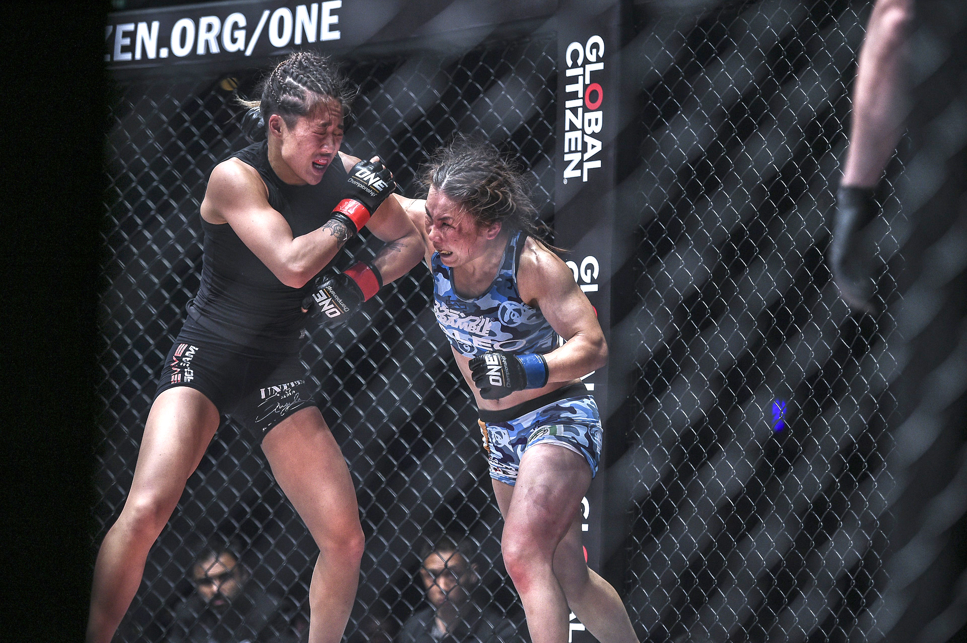 Mei 'V.V' Yamaguchi (right) throws a punch at champion Angela Lee during their ONE Championship atomweight title match on May 18 at Singapore Indoor Stadium | ONE CHAMPIONSHIP
