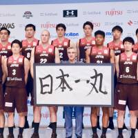 The Japanese men's national team poses with coach Julio Lamas (center) during a news conference on Monday. | KAZ NAGATSUKA