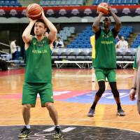 NBA players Matthew Dellavedova (left) and Thon Maker take shots during Australia's practice at Chiba Port  Arena on Thursday. Australia faces Japan in a FIBA World Cup Asian qualifier on Friday night at the same venue. | KAZ NAGATSUKA