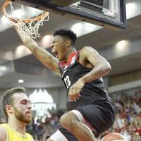 Japan's Rui Hachimura dunks in the fourth quarter against Australia on Friday night. Hachimura scored 24 points. | KYODO