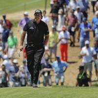 Phil Mickelson apologizes for breaking golf etiquette by hitting moving ball at U.S. Open