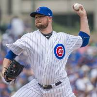 The Cubs' Jon Lester pitches against the Pirates on Saturday at Wrigley Field in Chicago.   USA TODAY / VIA REUTERS