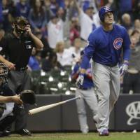 Cubs rally past Brewers in 11th, climb into first