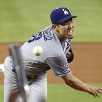 Los Angeles Dodgers pitcher Kenta Maeda was placed on the 10-day disabled list after suffering a hip strain on May 30. | KYODO