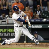 Astros rally past Rays for 12th straight victory