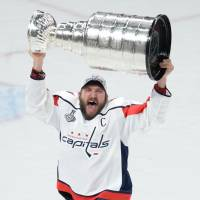 Washington's Alex Ovechkin hoists the Stanley Cup after the Capitals defeated the Vegas Golden Knights in Game 5 on Thursday night. | USA TODAY / VIA REUTERS